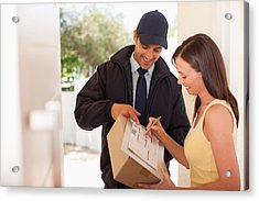 Woman Signing Box Receipt For Delivery Man Acrylic Print by Paul Bradbury