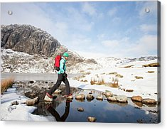 Woman Walker And Frozen Stickle Tarn Acrylic Print by Ashley Cooper