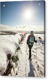 Woman Walking In Deep Snow Acrylic Print by Ashley Cooper