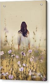 Woman Walking In Field Of Blue Flowers Acrylic Print by Sandra Cunningham