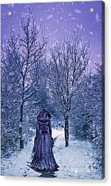 Woman Walking In Snow Acrylic Print by Amanda Elwell