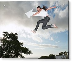 Woman With Blank Arrow Leaping Outdoors Acrylic Print by Robert Daly