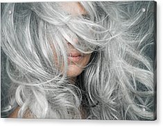 Woman With Grey Hair Blowing Across Her Face. Acrylic Print by Andreas Kuehn