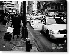 Yellow Cab On Taxi Rank Outside Madison Square Garden On 7th Avenue New York City Usa Acrylic Print by Joe Fox