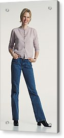 Young Beautiful Caucasion Adult Female Dressed Casually In Jeans And A Sweater Stands Smiling Confidently At The Camera Acrylic Print by Photodisc