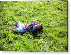 Young Boy Lying On Grass Acrylic Print by Samuel Ashfield