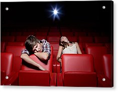 Young Couple Asleep In The Movie Theater Acrylic Print by Image Source