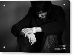 Young Dark Haired Teenage Man Sitting On The Floor With Back Against The Wall In The Fetal Position  Acrylic Print by Joe Fox