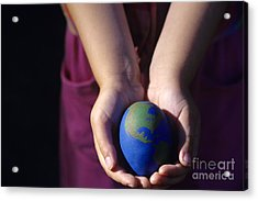 Young Girl Holding Earth Egg Acrylic Print by Jim Corwin
