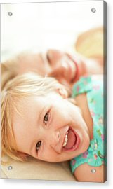 Young Girl Lying Down Laughing Acrylic Print by Ian Hooton