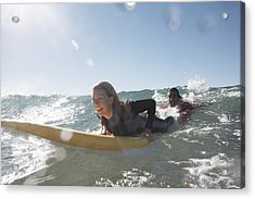 Young Man Being Towed In Sea By Young Woman On Surfboard, Smiling Acrylic Print by Anthony Ong