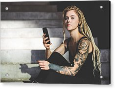 Young Tattooed Woman Texting Message On Mobile Phone Acrylic Print by Nikada