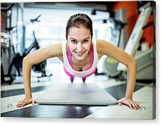 Young Woman Doing Press-ups Acrylic Print by Science Photo Library