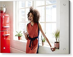 Young Woman Laughing In A Trendy Apartment Acrylic Print by Ezra Bailey