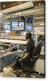 Young Woman Using Control Panel While Monitoring Computer Screens At Sawmill Acrylic Print by Hakan Jansson