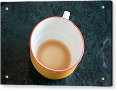 A Cup With The Remains Of Tea On A Green Table Acrylic Print by Ashish Agarwal