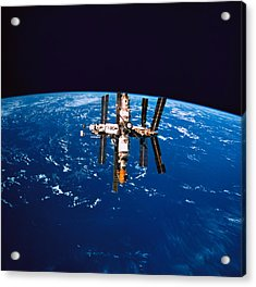 A Space Station In Orbit Above The Earth Acrylic Print by Stockbyte