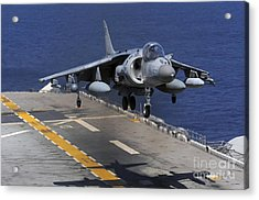 An Av-8b Harrier Jet Lands Acrylic Print by Stocktrek Images