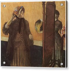 At The Milliner's Acrylic Print by Edgar Degas