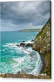 Cliffs Under Thunder Clouds And Turquoise Ocean Acrylic Print by Ulrich Schade