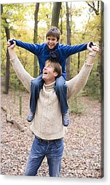 Father Carrying His Son In A Wood Acrylic Print by Ian Boddy