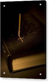 Gold Cross Pendant Resting On A Book Acrylic Print by Philippe Widling