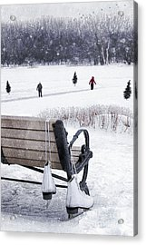 Ice Skates Hanging On Bench With People  Skating In Background Acrylic Print by Sandra Cunningham