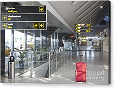 Luggage Sitting Alone In An Airport Terminal Acrylic Print by Jaak Nilson