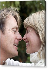 Smiling Couple Embracing Acrylic Print by Ian Boddy