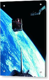 A Satellite Orbiting Above The Earth Acrylic Print by Stockbyte
