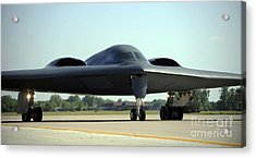 A B-2 Spirit Taxis Onto The Flightline Acrylic Print by Stocktrek Images