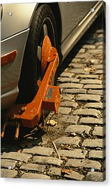 A Car With A Booted Tire Acrylic Print by Richard Nowitz