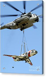 A Ch-53 Sea Stallion Lifts A Hu-25 Acrylic Print by Stocktrek Images