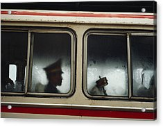 A Chinese Pla Soldier Sits On A Bus Acrylic Print by Justin Guariglia