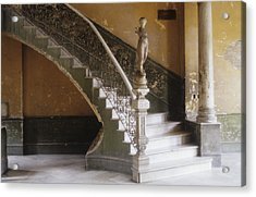 A Circular Marble Staircase And Statue Acrylic Print by Kenneth Ginn