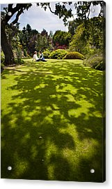A Couple Sits On A Dappled Lawn Acrylic Print by Taylor S. Kennedy