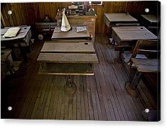 A Dunce Cap Sits On A Desk In An Acrylic Print by Hannele Lahti