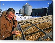 A Farmer Runs His Corn Through His Hand Acrylic Print by Joel Sartore