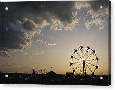 A Ferris Wheel Is Silhouetted Acrylic Print by Stephen Alvarez