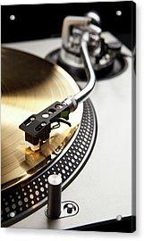 A Gold Record On A Turntable Acrylic Print by Caspar Benson
