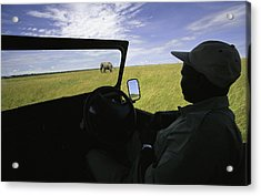A Guide In A Jeep Observing An African Acrylic Print by Michael Melford