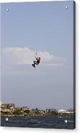 A Kiteboarder Jumps High Over Beach Acrylic Print by Skip Brown