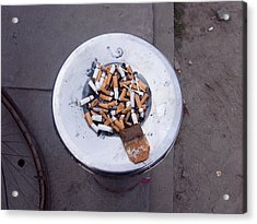 A Lot Of Cigarettes Stubbed Out At A Garbage Bin Acrylic Print by Ashish Agarwal