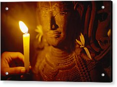 A Man Holds A Candle Up To A Stone Acrylic Print