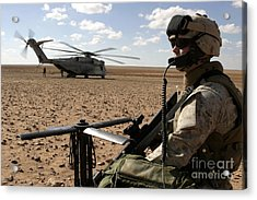 A Marine Assembles A Radio Antenna Acrylic Print by Stocktrek Images