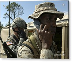 A Marine Communicates With Aircraft Acrylic Print by Stocktrek Images
