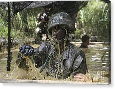 A Marine Splashes As He Makes His Way Acrylic Print by Stocktrek Images