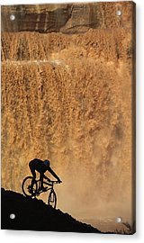 A Mountain Biker Pedals Past Rushing Acrylic Print by Bill Hatcher