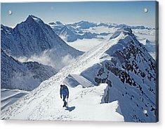 A Mountaineer On The Summit Ridge Acrylic Print by Gordon Wiltsie