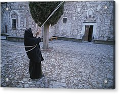 A Nun Pulls On Ropes In A Courtyard Acrylic Print by Tino Soriano